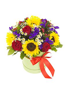 Kompozīcija ar saulespuķēm apaļā dāvanu kastē